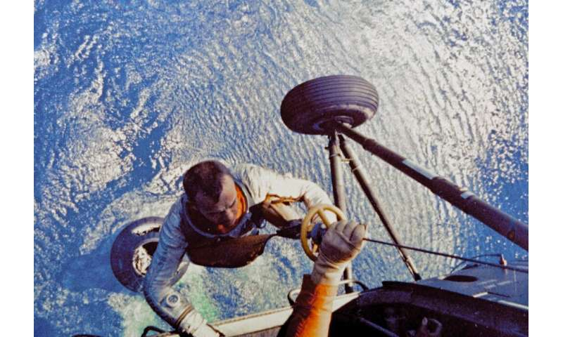 Alan Shepard, first US astronaut to travel to space, being collected by helicopter after his landing in the Atlantic Ocean on Ma