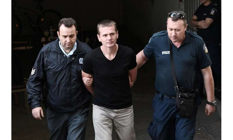Alexander Vinnik, now about to be tried in Paris for a multi-million euro fraud, arrives at a Greek courthouse in 2017 shortly