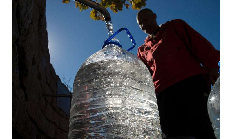A man collects drinking water from taps that are fed by a spring in Newlands on May 15, 2017, in Cape Town