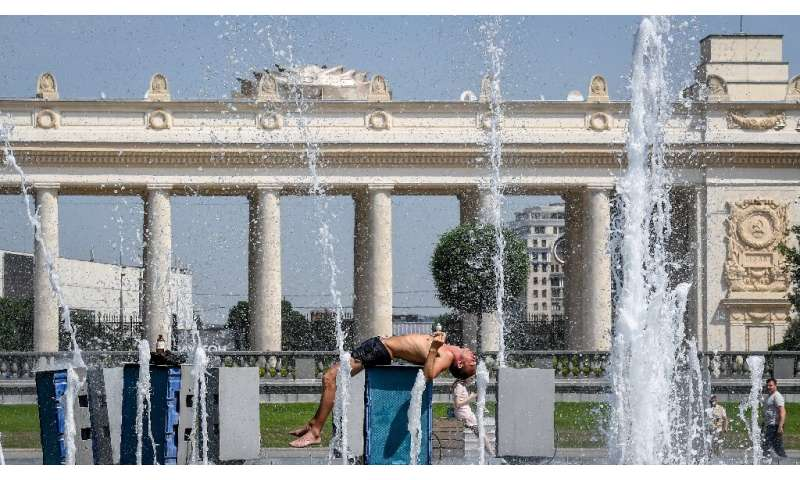 A man cools himself in a fountain in Gorky park in central Moscow