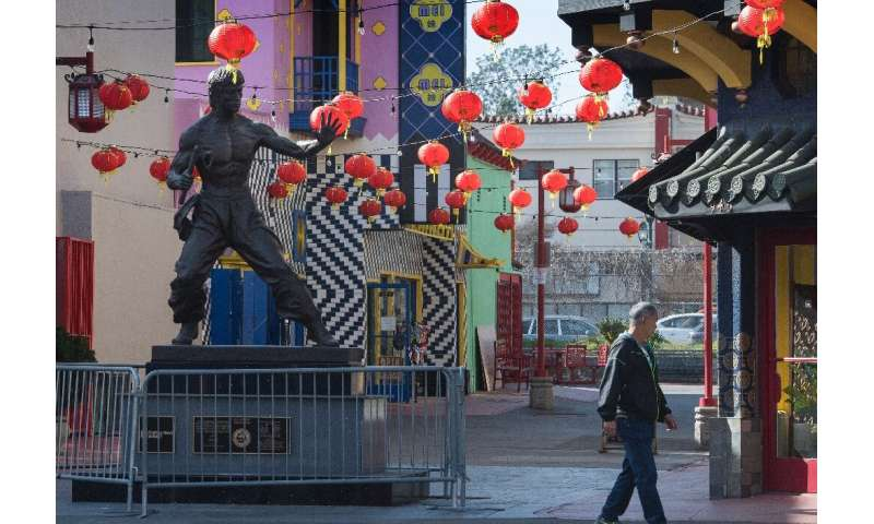 A man walks through an almost deserted Los Angeles Chinatown as most stay away due to fears over the novel coronavirus