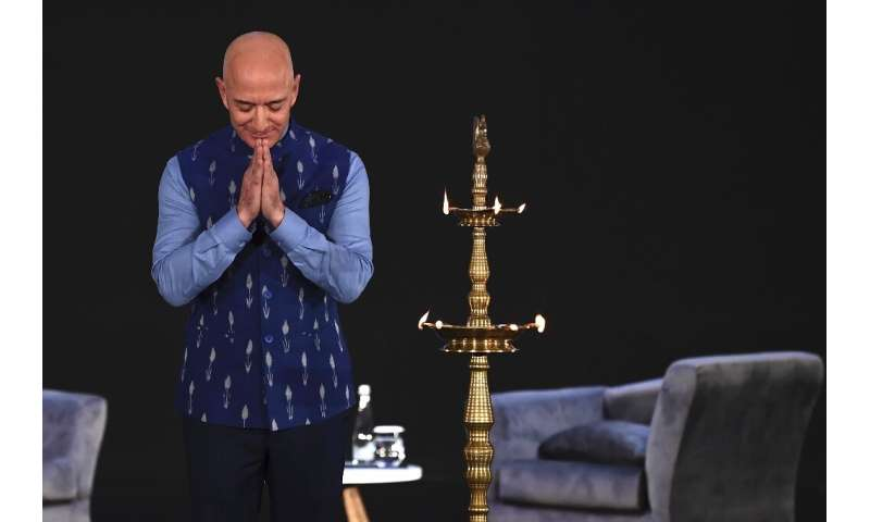 Amazon chief Jeff Bezos greets the audience at an Amazon meeting in New Delhi
