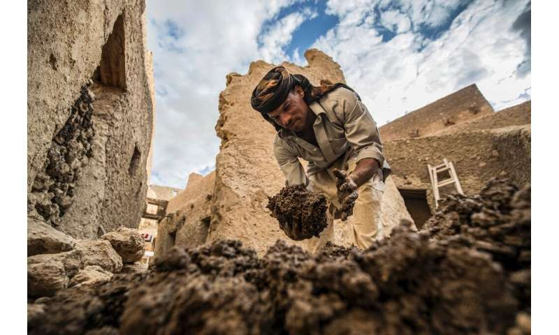 An Egyptian labouror works on the restoration of the Shali fortress