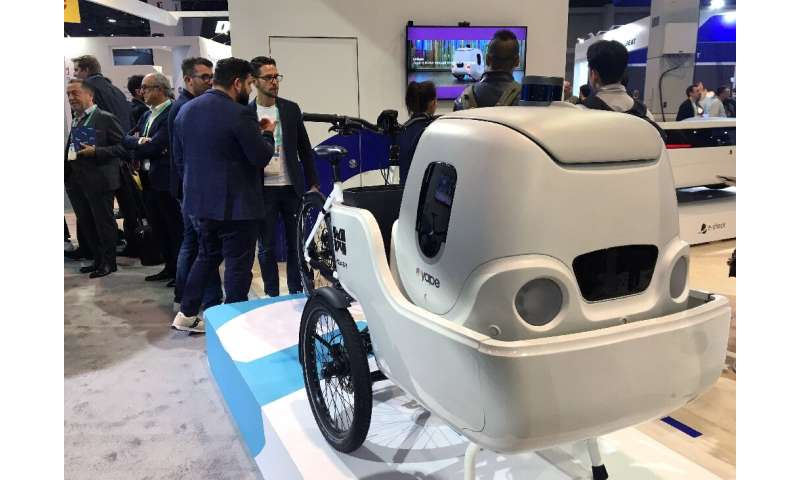 An electric cargo bike from Italian startup Measy uses a delivery robot from sister company Yape for multimodal transportation a