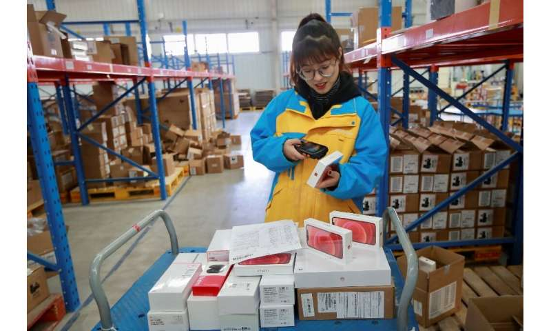 An employee checks items to be delivered to customers on Singles' Day, also known as the Double 11 shopping festival, at the war