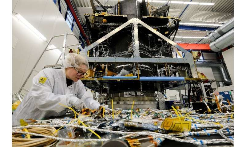 An employee works on a satellite at OHB Space Systems, a German firm that is holding its own against bigger European comptetitor
