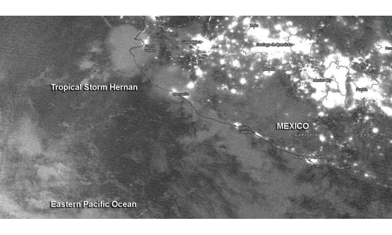 A nighttime view of Tropical Storm Hernan from a NASA-NOAA satellite