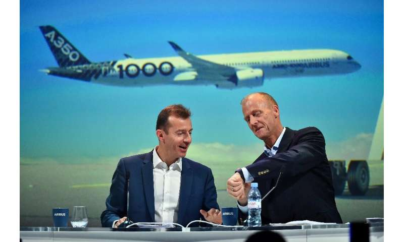 An internal Airbus probe was a factor in the departure of executive chairman Tom Enders (R), who was replaced as chief executive