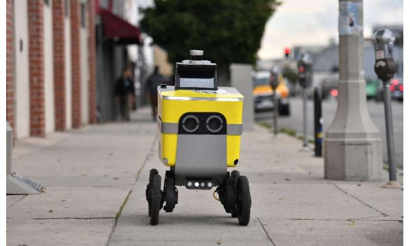 A Postmates delivery robot is seen on its route to deliver food to customers in Los Angeles on March 24