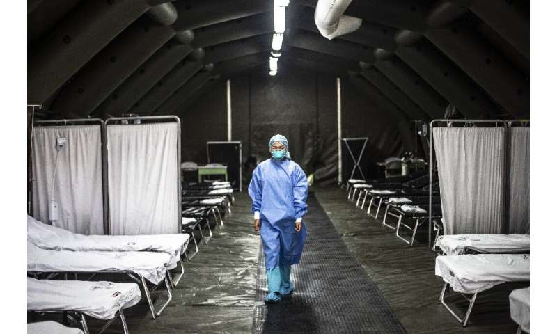 A specialist walks inside a mobile unit set up by the Peruvian Ministry of Health as a preventive measure against the virus at t
