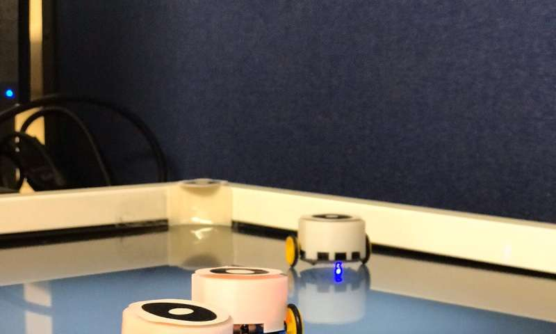 A system for swarm robotics applications inspired by pheromone communication in insects
