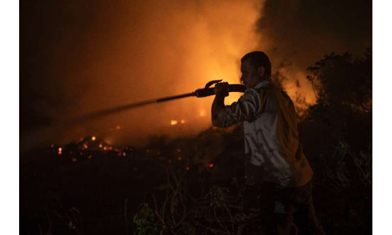 A volunteer combats a fire in Brazil's Pantanal, the world's largest tropical wetlands