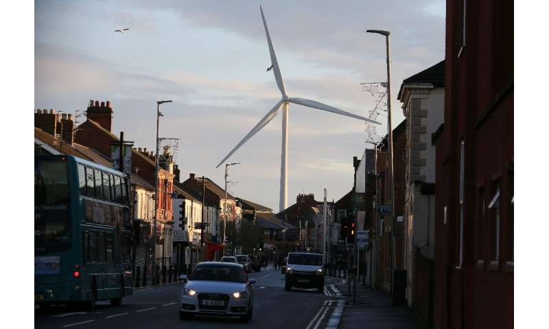 A wind turbine looms over Blyth, northeast England on December 13, 2019; Turnover in Britain's low carbon and renewable energy s