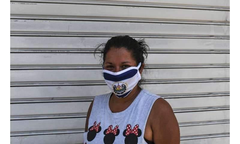 A woman in El Salvador, which joined several central and South American countries imposing quarantine measures to cope with the