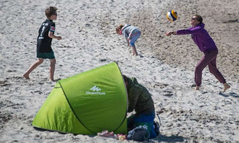 A woman plays volleyball with her son at the seaside resort of Binz, on the island of Ruegen in northeastern Germany.