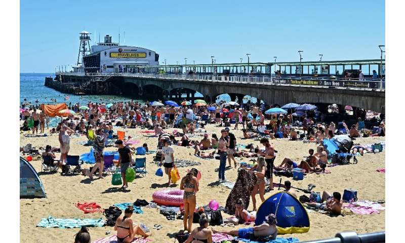 Beachgoers enjoy the sunshine in Bournemouth, southern England—but the crowded shore raised alarm bells for local officials worr