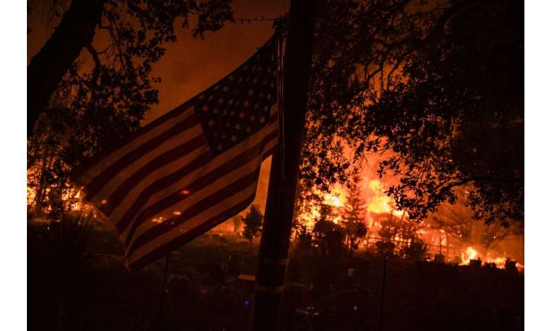 Buildings burn along Highway 12 as fire approaches Santa Rosa,  California on September 28, 2020