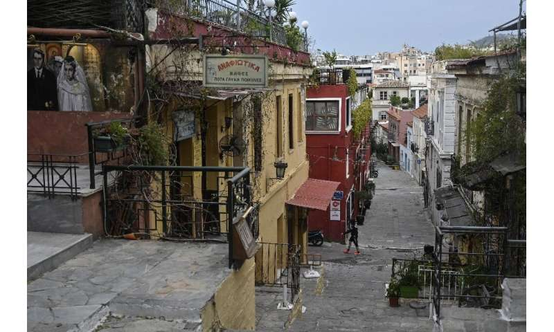 Cafes and taverns are closed in the popular Plaka tourist district of Athens during a lockdown aimed at curbing the spread of th