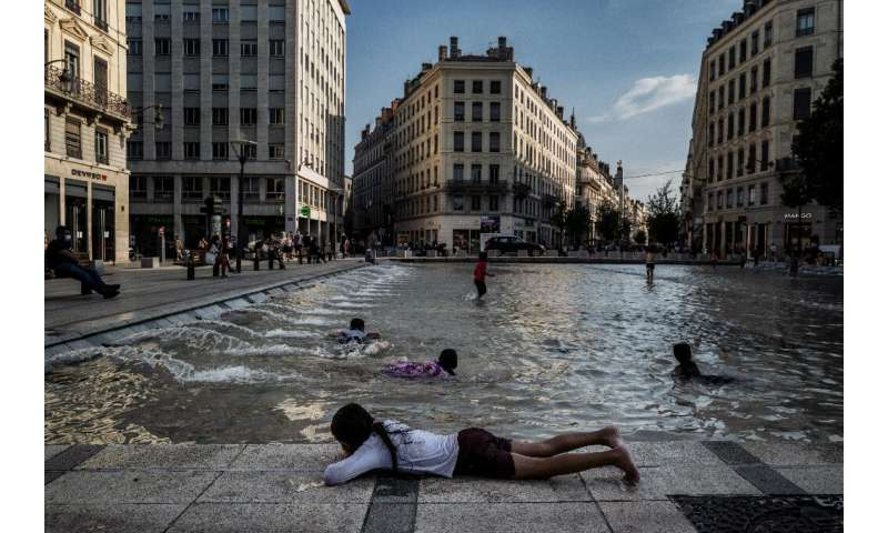 Children cooled off in a fountain in Lyon