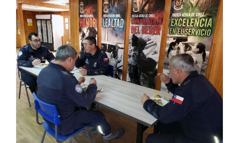 Chilean military personnel having lunch at the Eduardo Frei Antarctic base