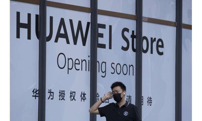 China accuses Britain of helping Washington hurt Huawei