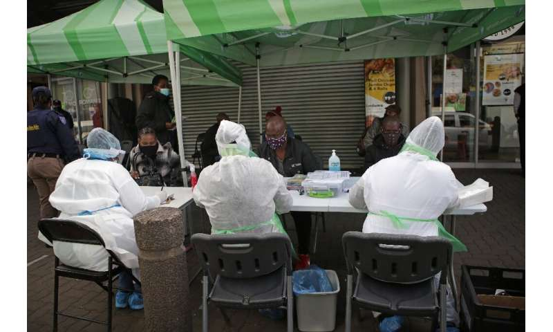 City of Tshwane Health officials conduct screening exercises on people before some of them will be tested for the COVID-19 coron