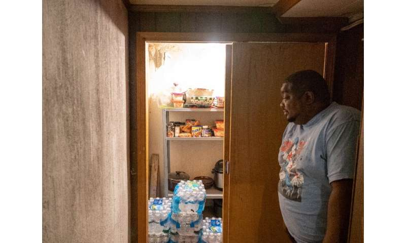 Cleophus Mooney of Flint, Michigan keeps his water in the basement and in the garage