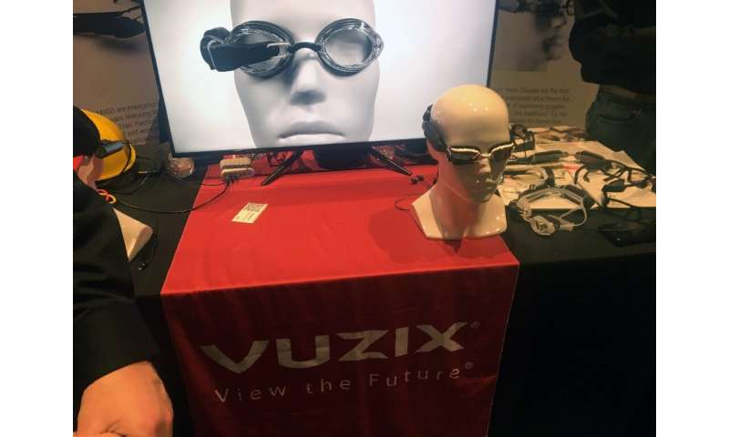 Connected Vuzix goggles which display information and entertainment to swimmers are displayed at the Pepcom exhibit on the sidel