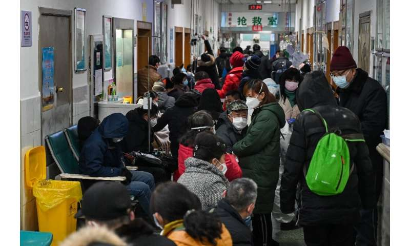 Crowds wait for medical attention at Wuhan Red Cross Hospital on January 25, 2020