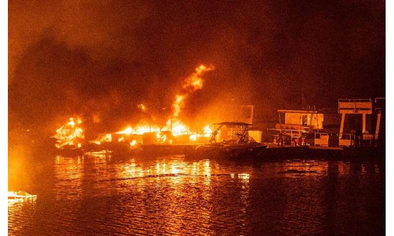 Docked boats burn on Lake Berryessa during the LNU Lightning Complex fire in Napa, California on August 19, 2020