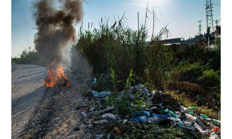 Dumped illegally alongside roadsides, some of the plastic waste is burned to get to metal, letting noxious fumes into the air