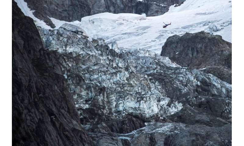During a helicopter flypast, an AFP reporter saw a gaping chasm on the lower part of the Planpincieux, from which two cascades o