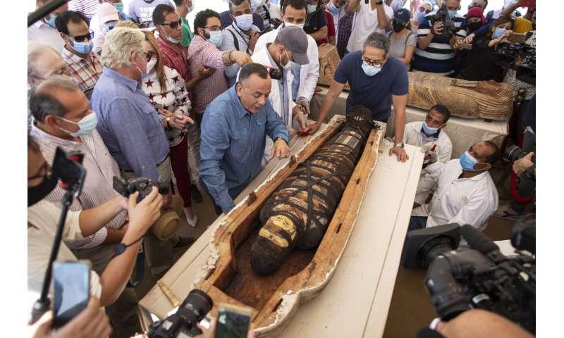 Egypt reveals 59 ancient coffins found near Saqqara pyramids