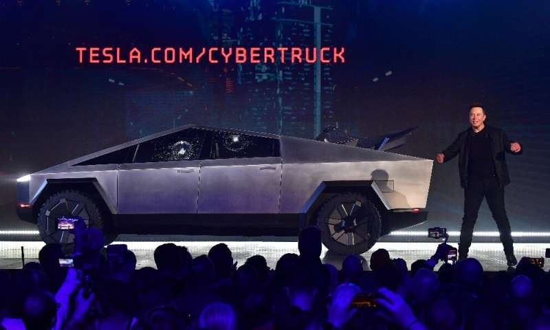 Elon Musk presents the all-electric battery-powered Tesla Cybertruck in November 2019. Analysts are expecting Tesla to have made