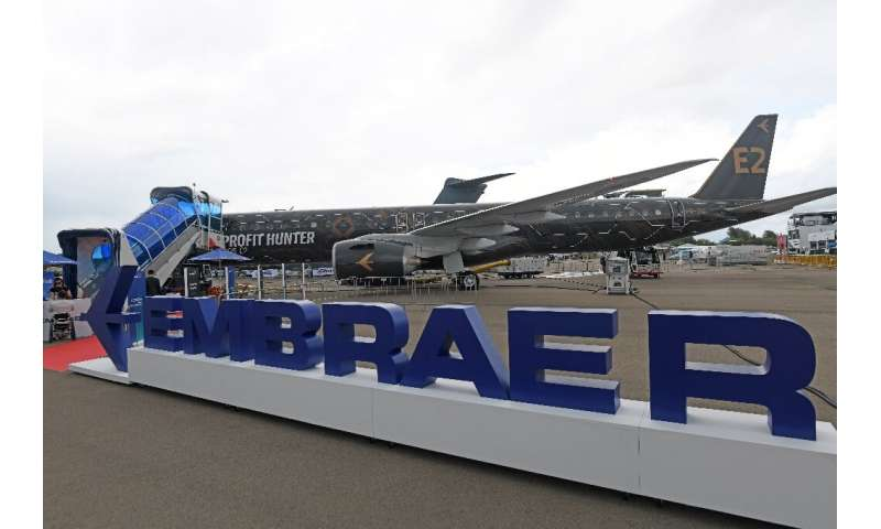 Embraer, which makes the E195-E2 jet airliner pictured here, announced $292 million in losses in the first quarter, when the COV