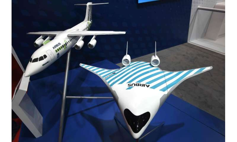 European plane maker Airbus has unveiled a model of a futuristic jet dubbed Maveric (right) which it says has the potential to c