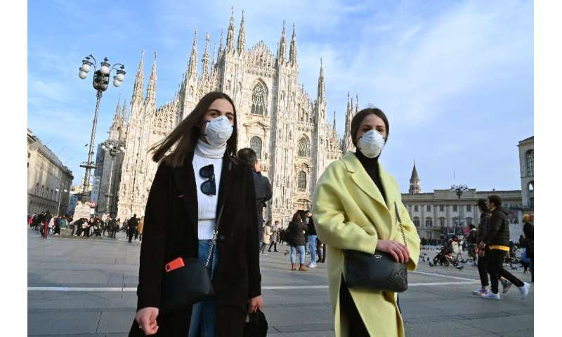 Face masks are being worn in Milan and other Italian cities