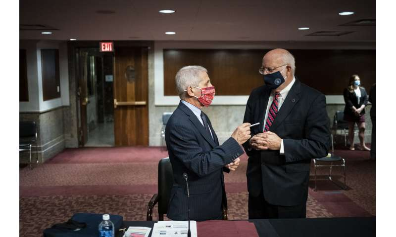 Fauci, CDC chief raise concerns about full airline flights