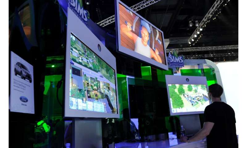 """(FILES) In this file photo taken on June 09, 2011 Gamers plays the video game """"Sims"""" at the Electronic Entertainment E"""