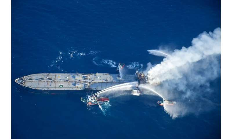 Fireboats battling to extinguish a fire on the Panamanian-registered crude oil tanker New Diamond off Sri Lanka's eastern coast