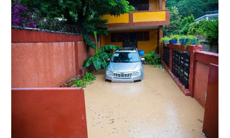 Floodwaters encircle a home in Pietonville, Haiti, after Storm Laura