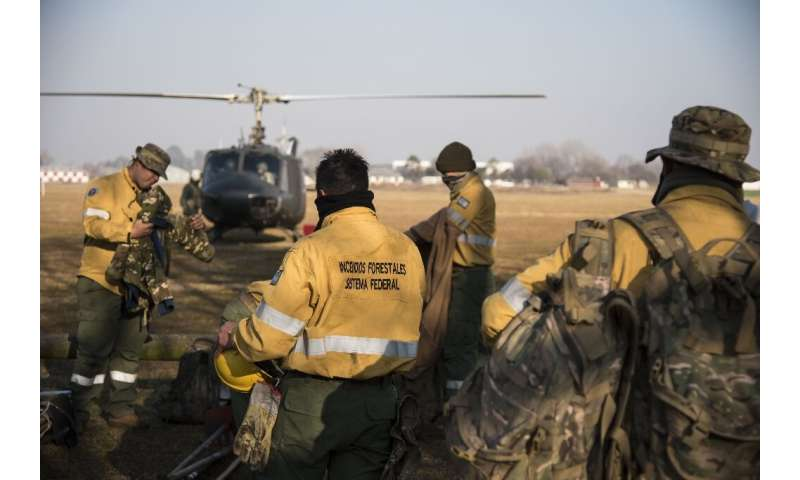 Forest fire fighters preparing to take to the skies to battle the thousands of fires raging across the Parana Delta marshes