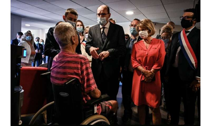 French Prime Minister Jean Castex, centre, warned of heat risks while visiting a retirement home