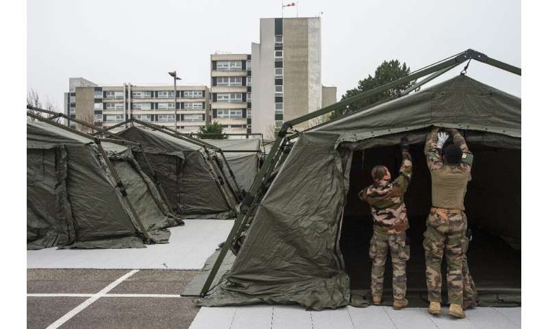 French soldiers have set up a field hospital in the northeast city of Mulhouse, where the hospitals are hard pressed