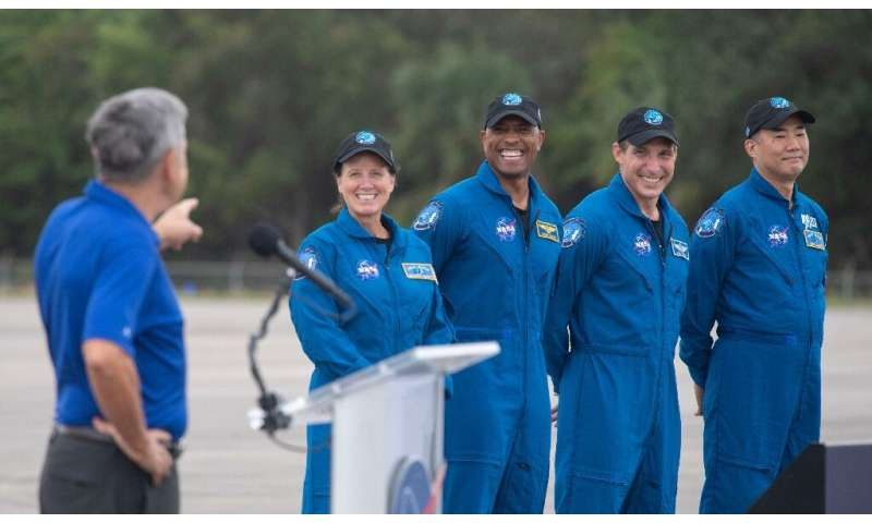 From left to right: NASA astronauts Shannon Walker, Victor Glover and Mike Hopkins, and Japanese astronaut Soichi Noguchi, seen