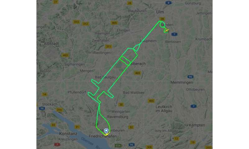 German pilot traces giant syringe in sky to mark Covid jabs thumbnail