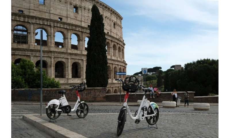 """Helbiz electric bikes outside the Colosseum in Rome on May 28, one of the """"micromobility"""" services seeing increased us"""
