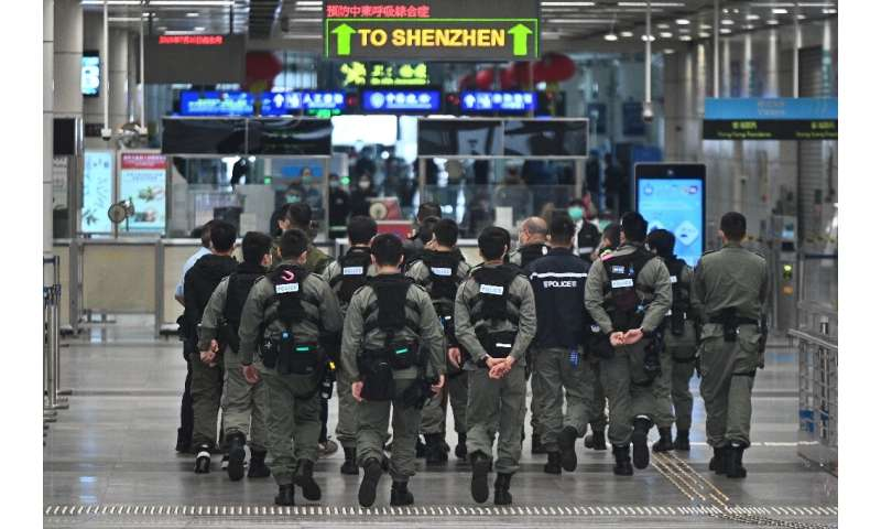 Hong Kong began enforcing a two-week quarantine for anyone arriving from mainland China, under threat of both fines and jail ter