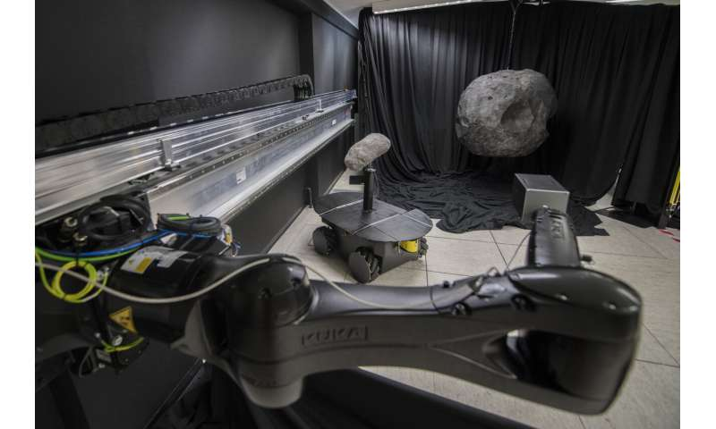 Image: Arm out to asteroid