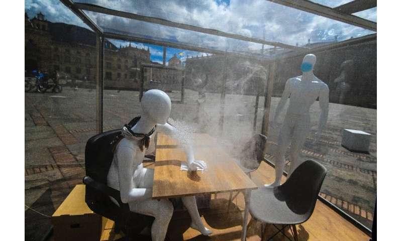 In Bogota, smoke comes out of a mannequin's mouth to show how the virus can spread